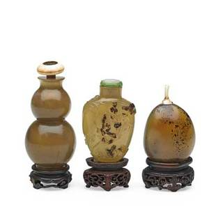 Chinese agate snuff bottles three all with lids and bases19th c tallest 3 34 with base