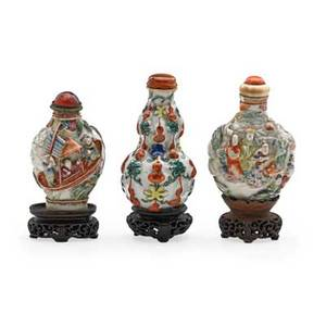 Chinese porcelain snuff bottles three with relief decoration lids and bases 19th c taller 3 with base