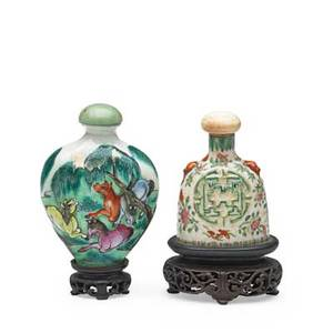 Chinese porcelain snuff bottles two with lids and bases 19th c taller 3 14 with base