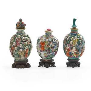 Chinese porcelain snuff bottles three with figural decoration caps and bases 19th c tallest 3 12 with base