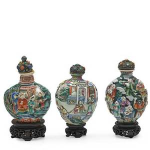Chinese porcelain snuff bottles three with figural decoration complete with spoons and bases 19th c tallest 4 with base