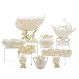Irish belleek porcelain nine shell pattern items including victoria and cardium 20th c two with black marks seven with gold largest 8 38 x 10