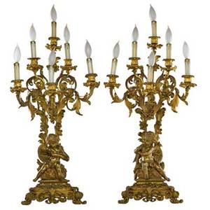 Pair of french bronze candelabra 6arm with seated cherubs at base mounted as lamps late 19thearly 20th c 30 x 9 x 6 fixture