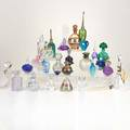Perfume bottles etc thirty perfumes one vase1980s signed orrefors vandermarkmerritt glass studios cio collection susan di marchi thomas buechner irving w rice  co and norman thomas et
