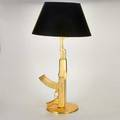 Philippe starck fios ak47 table lamp on circular base italy ca 2005 gold finish original black shade impressed inscription happiness is a hot gun 36 x 20 shade dia
