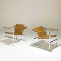 Le corbusier pair of basculant armchairs 1960s saddle leather chromed steel unmarked 25 12 x 25 x 25 12