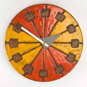 George nelson howard miller clock company wall clock zeeland mi 1960s orange and yellow glazed stoneware meridian clocks label 14 14 h