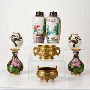 Asian decorative group nine pieces 19th20th c includes two footed brass bowls pair of chinese cloisonn cabinet vases pair of lidded porcelain jars with figural decorations etc most unmarked