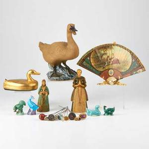 Traditional decorative twenty seven objects seventeen hat pins two female wax statuettes fan with stand four bird figurines lidded duck box and duck statue 20th c porcelain wax wood bone