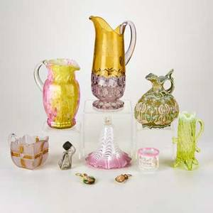 Glass group four pitchers smoke cap ink bottle most in colored glass together with two porcelain pieces and two shell trinkets 20th c one illegibly marked tallest 12 12