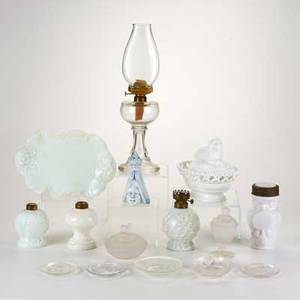 Glass group fifteen pieces including oil lamp lamp founts sugar caster pressed glass etc 20th c caster marked tallest 15 12
