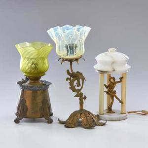 Traditional lighting three table lamps including desk lamp with adjustable shaft table lamp containing metal figurine with alabaster base and shade together with one hanging brass oil lamp with mi