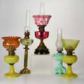 Oil lamp group five table lamps each with glass font and metal mounts one with alabaster shaft one electrified usa 19th20th c one illegibly marked tallest 28 12 x 6 dia