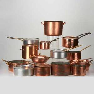 Copper kitchenware eleven pieces including saucepans and stockpots most with lids together with three aluminum covered saucepans france new york earlymid20th c most marked largest 5 x 9