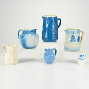 Glazed stoneware four pitchers together with two parian ware porcelain pitchers 20th c all unmarked tallest 8 12