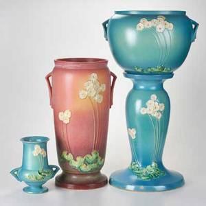 Roseville primrose umbrella stand 773 twohandled vase 7668 jardinire 63410 and pedestal zanesville oh late 1930s glazed earthenware dieimpressed marks to three tallest 29 14