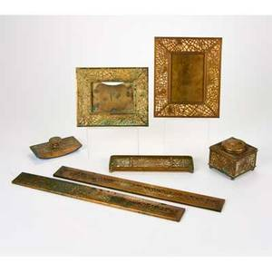 Tiffany studios sevenpiece pine needle desk set new york ca 1920s gilt bronze glass includes two frames 939 947 inkwell pen tray blotter 995 and pair of blotter ends 999 all but tw