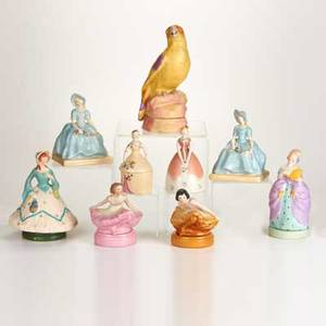 Fulper nine pieces two garland book blocks parrot perfume lamp two ballerina perfume lamps two figural porcelain lamps and two figural powder boxes flemington nj after 1928 glazed earthenwar