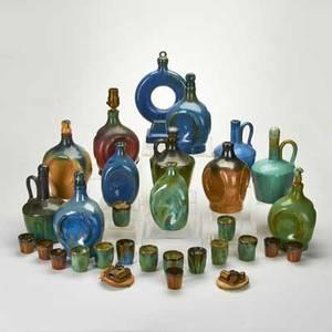 Fulper twentynine pieces including ten musical decanters music boxes sixteen shot glasses etc flemington nj late 1920s glazed earthenware some marked tallest 12 12