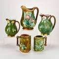 European majolica five pitchers with floral motifs 19th  20th c unmarked tallest 9 14