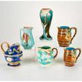 European majolica five pitchers and a vase decorated with flowers putti shells and wheatgrass 19th  20th c two unrecognized marks tallest 9 34