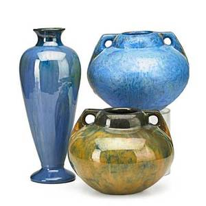 Fulper three vases flemington nj 1910s pair of twohandled vases and one baluster vase in assorted glazes all with vertical marks tallest 12 x 4 12