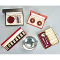 Cartier and other sterling giftware 20th c cased set of four cartier parcel gilt salt and four pepper shakers meka danish red enameled silver smoking set e dragsted pair of silver gilt and red e