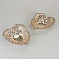 Two gorham silver heartshaped baskets 19th and 20th c with rococo pierced repousse 1857 ot 9 12 x 8