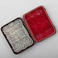 Nathaniel mills silver castle top card case birmingham 1841 front and reverse depict views of castle raised among scroll and floral chasings inscribed mm ogden in original burgundy leather and