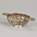 Dutch silver handled drinking bowl 18591893 lobed oval repousse cuelle depicts rustic vignettes cast and pierced cherub and floral handles ring foot impressed faux guild marks contoured fish c