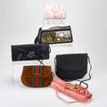 Six designer handbags carlos falchi pink python clutch with python skin flowers and shoulder strap 11 x 4 x 2 rene mancini black silk and file envelope with braided silk cord 7 x 8  oscar
