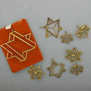 Paul von ringelheim geometric stars of david eight gilt brass prototypes for pendants ca 1972 one signed largest 2 38 x 2 12 from the estate of the artist