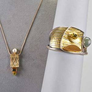 Contemporary studio jewelry two pieces sterling 22k and 14k gold open cuff with 14 ct moonstone peridot and druzy possibly caroline strieb silver pendant necklace with peridot citrine and pea