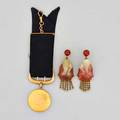 Gold jade earrings and gold locket fob three pieces 19121935 chinese carved whitered jade ear pendants depict seated sages with twistbar fringe carnelian surmounts screw closure 2 38 10k g