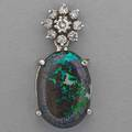 Black matrix opal and diamond pendant oval opal specimen 182 x 123 mm with bluegreen color play suspends from circular diamond cluster approx 40 ct tw at least 10k wg 33 dwt 1 18