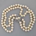 Double strand pearl and diamond necklace ca 1955 two concentric strands of spherical japanese cultured pearls 87  77 mm diamond frond and twin pearl clasp approx 65 ct tw 1 accommodates