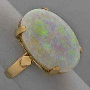 14k yellow gold opal ring ca 1960 oval opal cabochon 23 x 17 mm approx 6 cts above fancy scroll gallery 63 dwt size 6