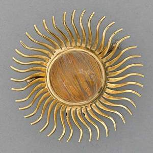 Rutilated quartz 18k gold sunburst brooch 20th c 18k yg continental marks 77 dwt 1 12