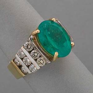 Emerald and diamond 14k yellow gold ring oval faceted emerald approx 370 cts and sixteen round brilliant cut diamonds approx 1 cts tw 60 dwt size 6