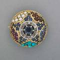 Jeweled 18k gold bombe brooch ca 1955 circular faceted sapphire framed by diamonds and surrounded by sapphires rubies pearls and turquoise petit point in star design 56 dwt 78 x 12