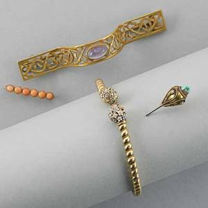 Four victorian gold jewelry items 10k gold sprung bracelet with enamel 10k gold amethyst scarf pin 14k gold coral bar pin 14k gold trimmed hatpin with seed pearls and turquoise damaged 168 dwt