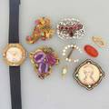 Gold or silver jewelry watch an opal nine pieces 19th and 20th c rococo enameled gold brooch with spinels jeweled gold cornucopia foilbacked amethyst gold brooch two gold bails pearl horsesh