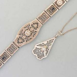 Art deco white gold and diamond jewelry ca 1930 14k gold stamped filigree strap bracelet with sapphire accents 7 triangular filigree pendant on chain 1 38 and 18 diamonds 15 ct tw neckl
