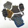 Eight beaded crochet evening bags 19101930 includes glass and cut steel examples longest 9 12 beyond fringe losses and damage