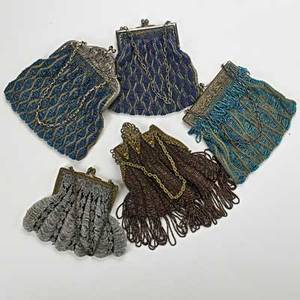 Five beaded crochet evening bags ca 19101930 gilt and silveredmetal frames longest 8 12 losses and damage one broken frame