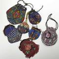 Seven beaded evening bags ca 1900 all bold in rich color some cobalt glass beads two have tortoise shell frames largest 8 12  international bids and bids issuing from the state of california
