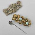 Two art nouveau sash ornaments and a hat pin two sash ornaments and a homeric silver hat pin ca 1900 metal and silver longest 4 34