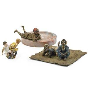 Vienna coldpainted figural bronzes five early 20th c middle eastern boy on marble tray girl with scarf signed bergman middle eastern boy reclining boy and girl on seat and square carpet signed