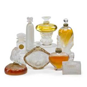 Lalique perfume bottles eight perfume bottles in varied sizes and shapes late 20th c all marked tallest 6