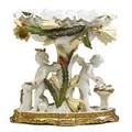 Moore brothers porcelain compote cherubs working as blacksmiths beneath foliate decorated bowl england late 19th c signed 10 34 x 10 12 x 8